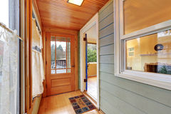 Entrance porch interior with wood paneling Stock Images