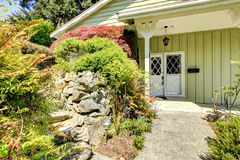 Entrance porch with landscaped front yard Royalty Free Stock Photos