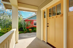 Entrance porch with light yellow door Stock Photos