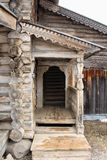 Entrance with a porch in the old house. Royalty Free Stock Image