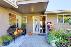 Entrance porch with pumpkin decoration Stock Photos