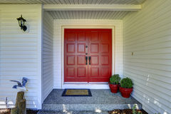 Entrance porch with red door Royalty Free Stock Image