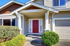 Entrance porch with red front door stock photos