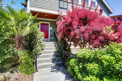 Entrance porch with red front door and staircase. Royalty Free Stock Photo