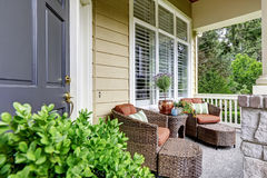 Entrance porch with wicker patio set Royalty Free Stock Images