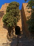Entrance port of the Alcazaba moorish castle, Malaga. On a sunny day with clear blue sky Royalty Free Stock Photos