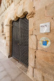 Entrance of the Pousadas de Portugal Historical Hotel in the medieval Flor da Rosa Monastery. Stock Photos