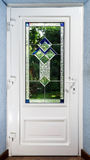 Entrance pvc door with tiffany leaded pane. For villagee house Stock Image