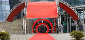 Entrance with red carpet to television Stock Photo
