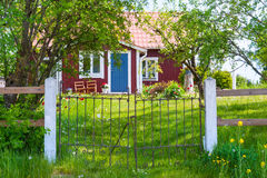 Entrance of red wooden cottage in Sweden Stock Image