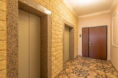 Entrance of a residential building with an elevator Stock Photos