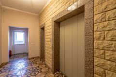 Entrance of a residential building with an elevator Royalty Free Stock Images