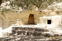 Entrance of a rock-hewn church in a gulch on Crete Stock Photography