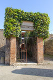 Entrance of ruined villa in Pompeii Stock Images