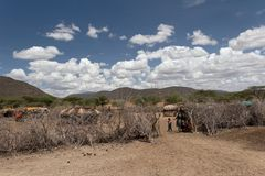 Entrance of a Samburu tribal village. With protective walls and children inside royalty free stock images