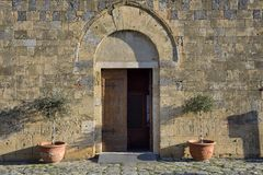 The entrance of Santa Maria Church (Monteriggioni) Royalty Free Stock Photo