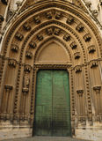 A entrance at Seville cathedral Stock Photos