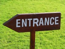 Entrance Sign. A wooden Entrance Sign pointing directions Royalty Free Stock Photo