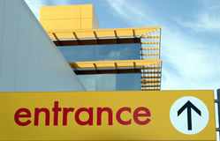 Entrance sign. Yellow Entrance sign on blue sky background Royalty Free Stock Photography