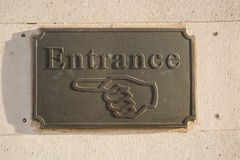 Entrance sign. A bronze entrance sign on a stone building Stock Image