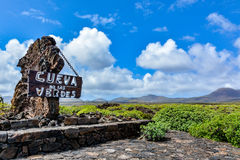 Entrance sign in front of Cueva de los Verdes, an amazing lava tube and tourist attraction Royalty Free Stock Photos