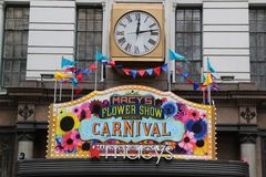 Entrance sign at the Macy`s Herald Square during `Carnival` theme flower decoration during famous Macy`s Annual Flower Show. NEW YORK - APRIL 4, 2017: Entrance Stock Photography