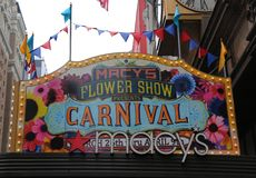 Entrance sign at the Macy`s Herald Square during `Carnival` theme flower decoration during famous Macy`s Annual Flower Show. NEW YORK - APRIL 4, 2017: Entrance Royalty Free Stock Photos