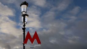 Entrance sign of the Moscow metro on a background of the sky. Russia stock video footage