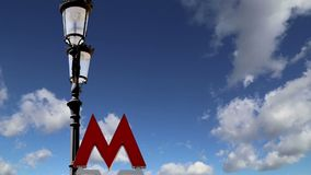 Entrance sign of the Moscow metro on a background of the sky. Russia stock video