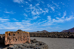 Entrance sign to Los Hervideros, Lanzarote island. Entrance sign to Los Hervideros, a place where lava streamed into the ocean, one of the most famous tourist Royalty Free Stock Images