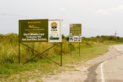 Entrance signs to Queen Elizabeth National Park, Uganda. Billboards with welcome message to Queen Elizabeth National Park, Uganda, Africa Royalty Free Stock Images