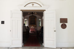 Entrance in small Christian church Royalty Free Stock Images