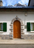 Entrance of a small house in the mountains. Typical construction of Pirineos, with a beautiful wood door at the entrance Stock Photography