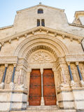 Entrance of St.Trophime church in Arles, France. Beautiful sophisticated architecture of entrance door of Church of Saint Trophime in Arles, France Stock Photos
