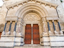 Entrance of St.Trophime church in Arles, France. Beautiful sophisticated architecture of entrance door of Church of Saint Trophime in Arles, France Royalty Free Stock Photo