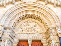 Entrance of St.Trophime church in Arles, France. Beautiful sophisticated architecture of entrance door of Church of Saint Trophime in Arles, France Stock Image