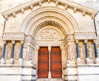 Entrance of St.Trophime church in Arles, France. Beautiful sophisticated architecture of entrance door of Church of Saint Trophime in Arles, France Stock Photography