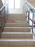 Entrance stairs closed with rope, no entry sign. Stock Image