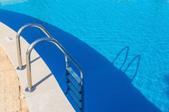 Entrance steps in the pool. Royalty Free Stock Photo