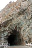 Entrance into stone cave Stock Photos