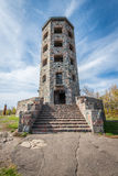 Entrance of stone tower. Front entrance of a stone tower during autumn time Stock Image