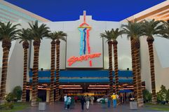 The entrance of the Stratosphere Hotel and Casino lights up at dusk. stock photos