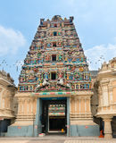 Entrance in a temple with Hindu Gods on gopuram Royalty Free Stock Photos