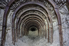 Entrance to abandoned chalk adit. Metal mine roof supports Stock Photos