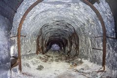 Entrance to abandoned chalk adit. Metal mine roof supports.  royalty free stock photography