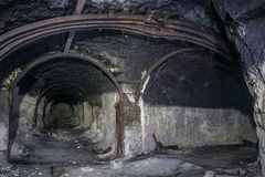 Entrance to abandoned chalk adit. Metal mine roof supports Royalty Free Stock Images