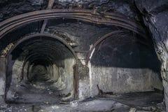 Entrance to abandoned chalk adit. Metal mine roof supports. Entrance to abandoned chalk mine. Metal mine roof supports, fork in the tunnel royalty free stock images