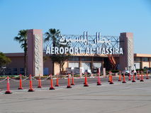 Entrance to airport in AGADIR city in MOROCCO. With clear blue sky in 2017 warm sunny winter day. Arabic words means: Al Massira Airport, Africa on February Stock Image