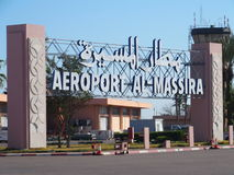 Entrance to airport in Agadir, Morocco. AGADIR, MOROCCO, AFRICA on FEBRUARY 2017: Entrance to airport in moroccan city with rows of red cones and clear blue sky Royalty Free Stock Image