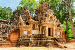 Entrance to ancient Thommanon temple in Angkor, Siem Reap. Entrance to ancient Thommanon temple in amazing Angkor, Siem Reap, Cambodia. Mysterious Thommanon Stock Photo
